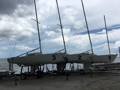 J22 3 boats sailboat